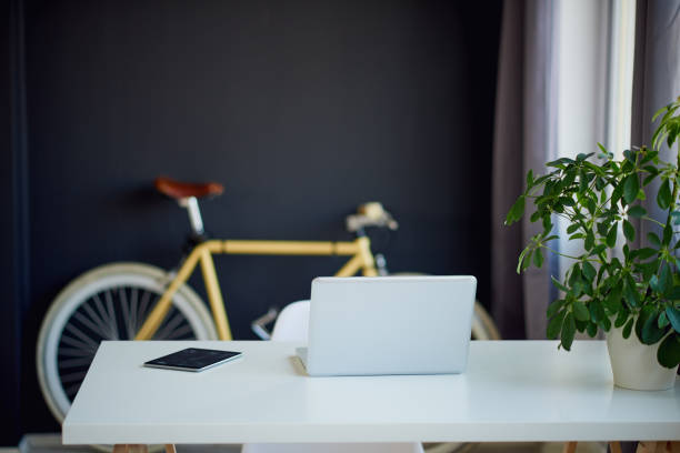 Loft Designed Working Space Loft Designed Working Space with bicycle empty desk stock pictures, royalty-free photos & images