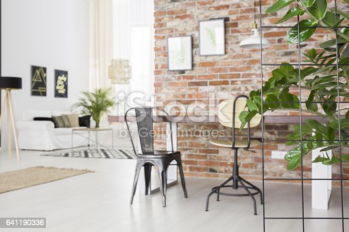 660325278istockphoto Loft interior with dining table 641190336