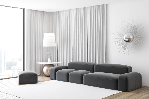 Loft living room corner, gray couch stock photo