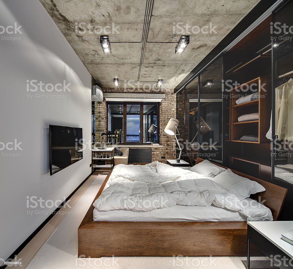Loft style bedroom stock photo