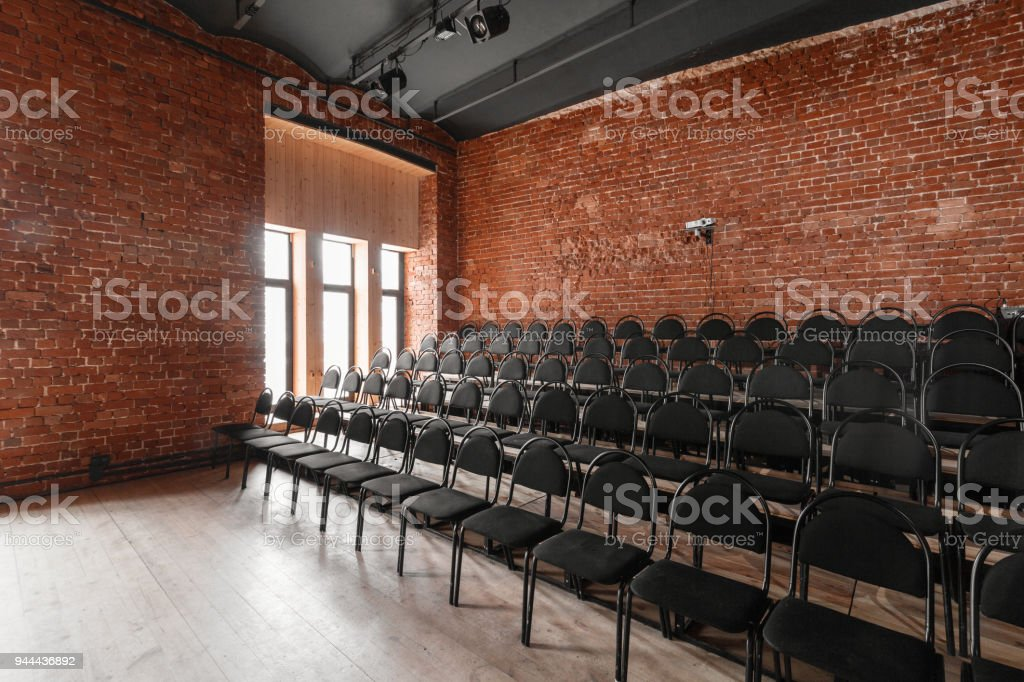 Loft style. Hall with black chairs for webinars and conferences. A huge room with & Loft Style Hall With Black Chairs For Webinars And Conferences A ...