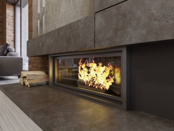 Loft-style designer fireplace, built-in firebox with burning fire and firewood.