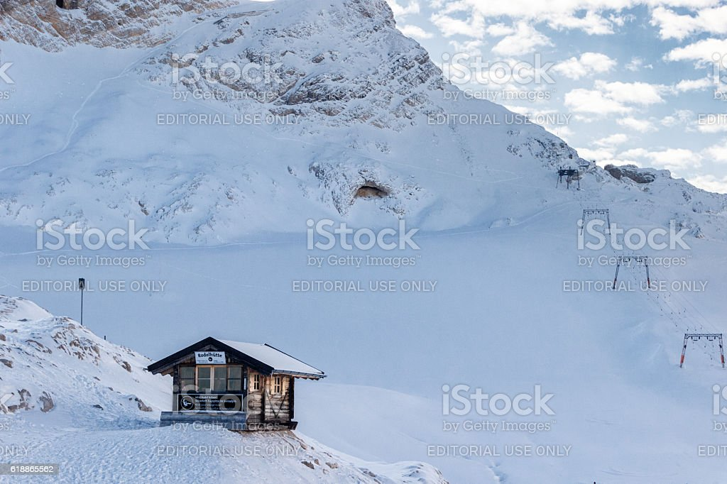 Log cabin and ski lift on a snow-covered mountain slope stock photo