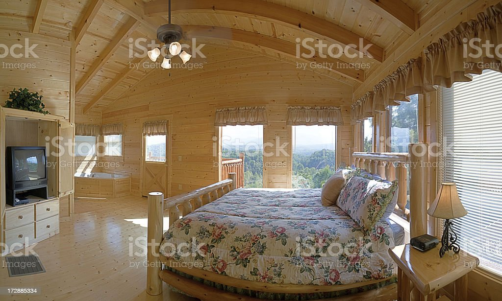 Log Cabin Bedroom with a view royalty-free stock photo