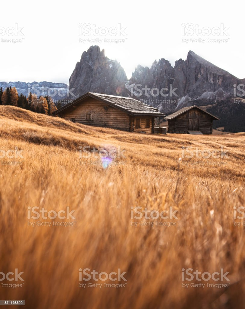log cabin in seiser alm stock photo