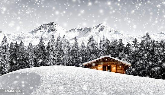 Log cabin in snowy mountain landscape