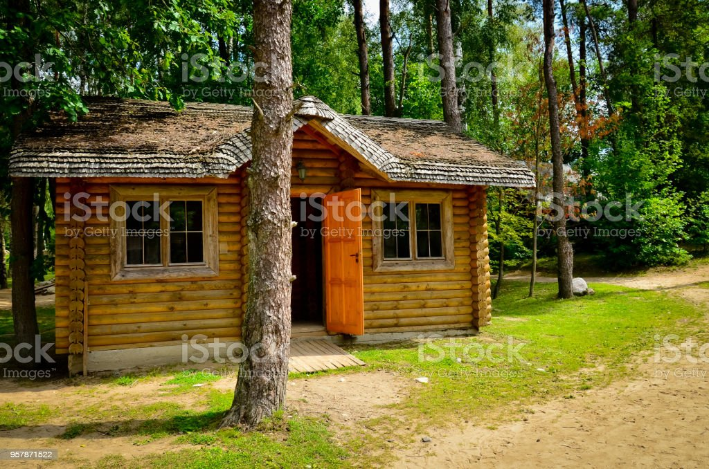 Log cabin in woods stock photo