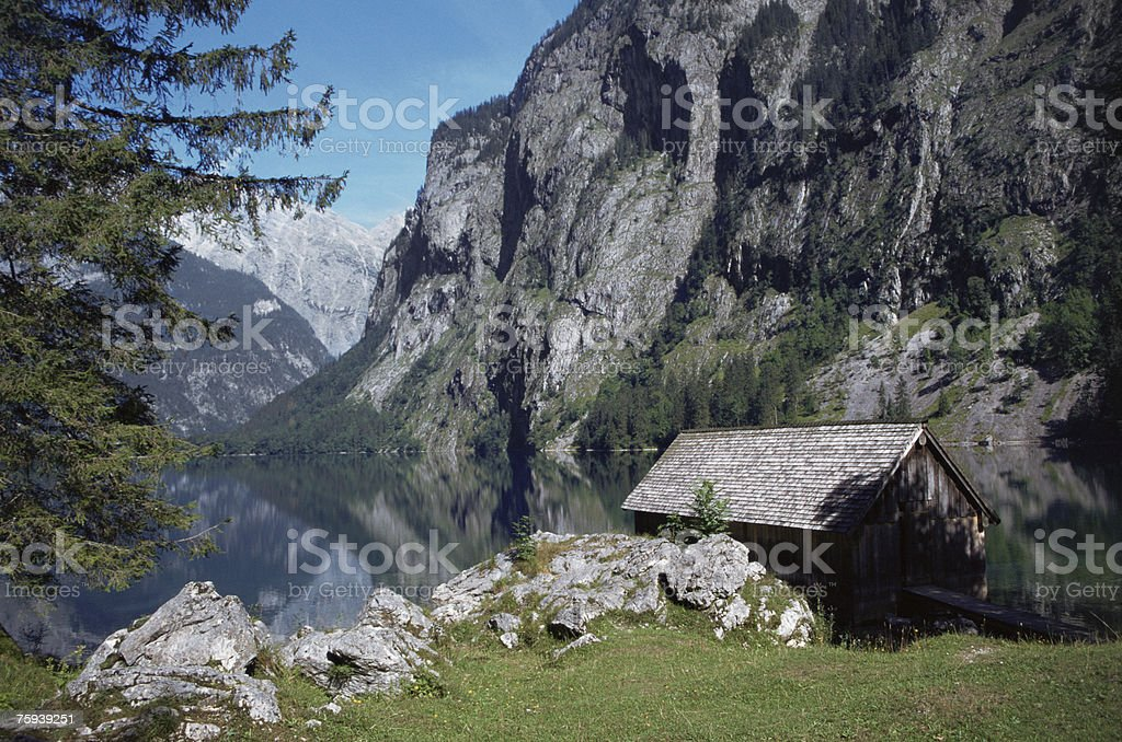 A log cabin next to upper lake royalty-free stock photo