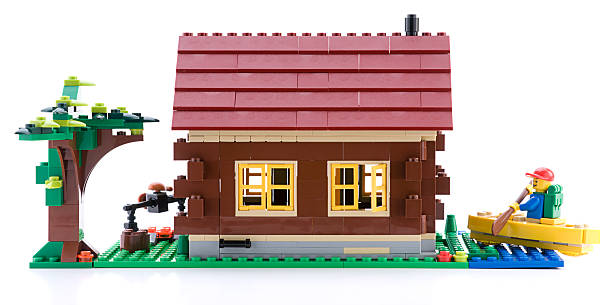 lego creator log cabin - lego house stock photos and pictures