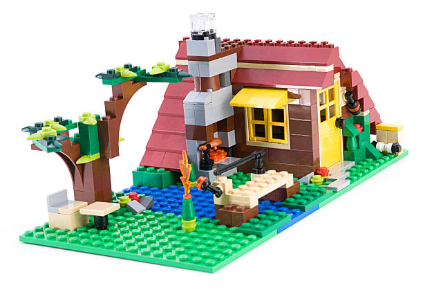lego log cabin - lego house stock photos and pictures