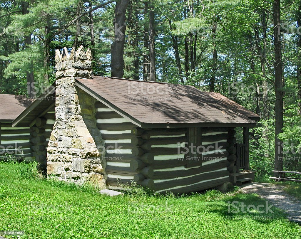 Log cabin with crown-topped chimney royalty-free stock photo