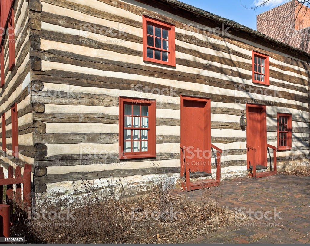 Log Cabin with Red Window Frames and Doors royalty-free stock photo