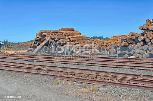 this log deck is a pile of logs and are normally placed at a landing which can be unstable, caution is necessary around lumber yards the Logs come from Forest where they are selected then cut down then processed by removing the limbs and cutting to desired length then placed on the log deck until loaded on train cars or logging trucks for delivery.