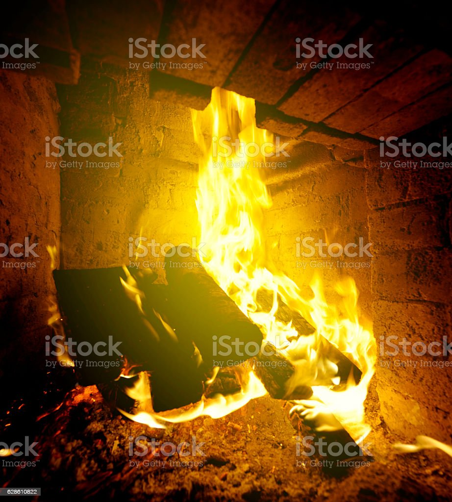 Log Fire on winter night stock photo