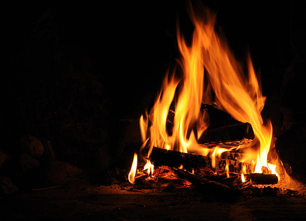 Log fire Log fire on black background bonfire stock pictures, royalty-free photos & images