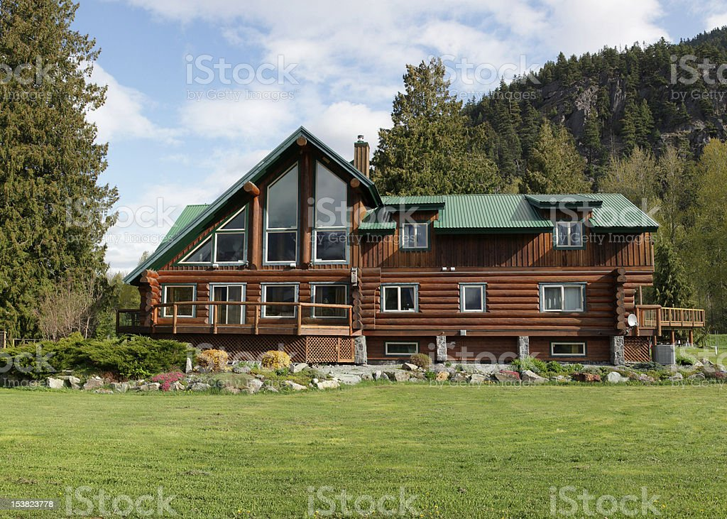 Log home in the mountains. stock photo