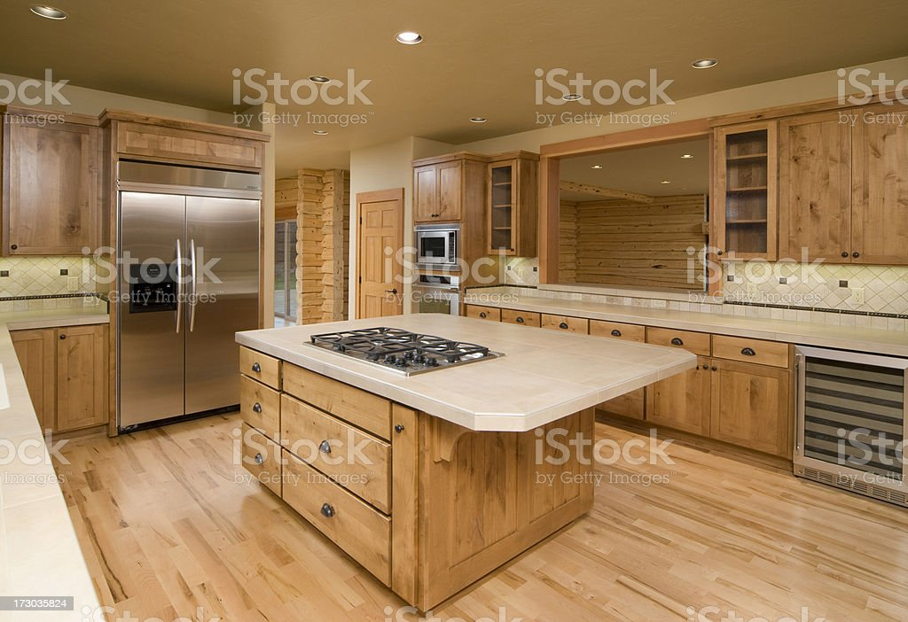 Log home kitchen with a island.