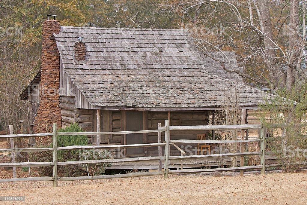 Log House And Split Rail Fence stock photo
