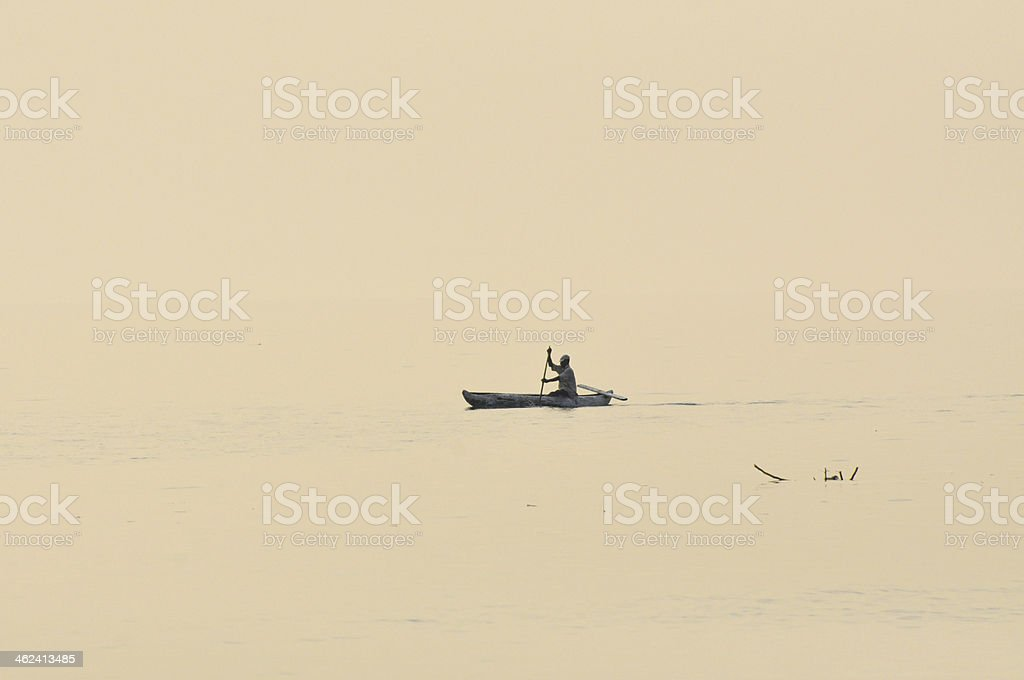 Logboat with African on Lake Malawi stock photo