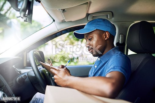 635967404 istock photo Logging every one of his deliveries 635967916