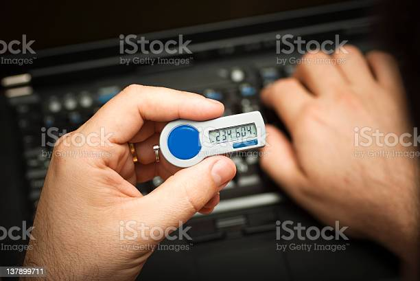 Logging On Using A 2nd Factor Authentication Token Stock Photo - Download Image Now