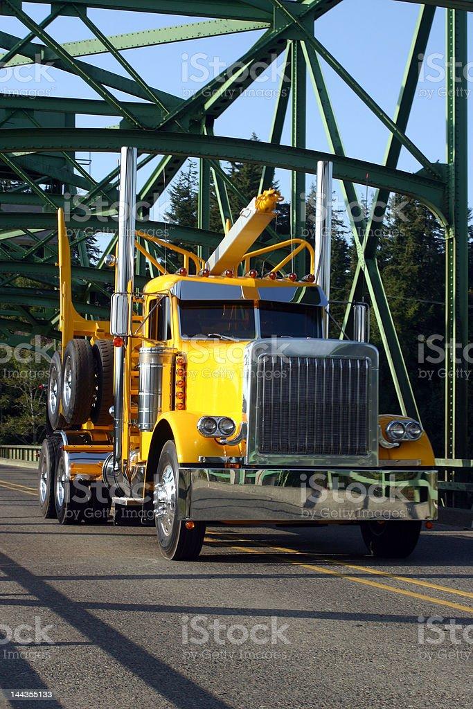 logging truck on bridge royalty-free stock photo