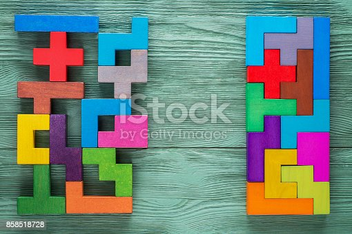 istock Logical tasks composed of colorful wooden shapes. Business concept. 858518728