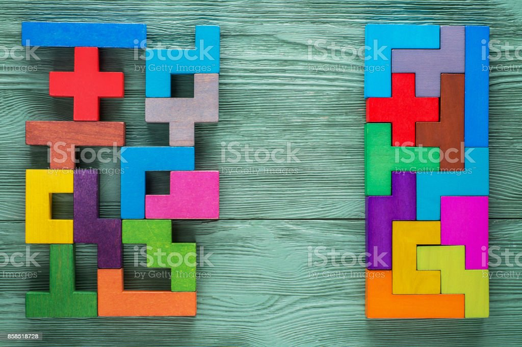 Logical tasks composed of colorful wooden shapes. Business concept. stock photo