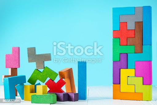 istock Logical tasks composed of colorful wooden shapes. 865832994