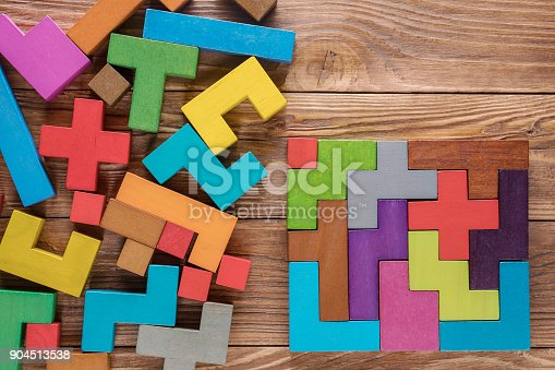 istock Logical tasks composed of colorful wooden shapes. Visual conundrum. Concept of creative, logical thinking or problem solving. Business concept, rational solution. 904513538