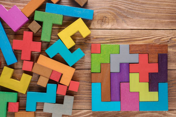 Logical tasks composed of colorful wooden shapes. Visual conundrum. Concept of creative, logical thinking or problem solving. Business concept, rational solution. stock photo