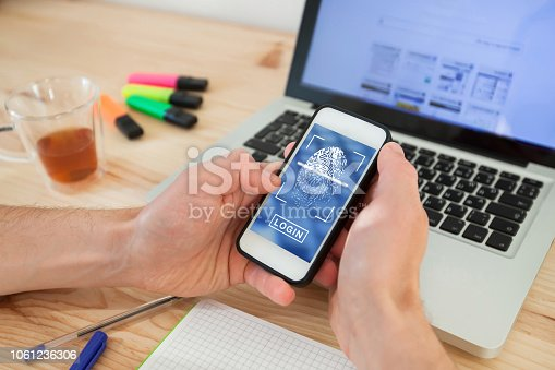istock Login access with fingerprint on smartphone. 1061236306