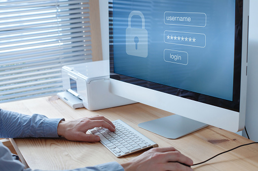 Login And Password To Access Secured Data Online On Computer Stock Photo - Download Image Now
