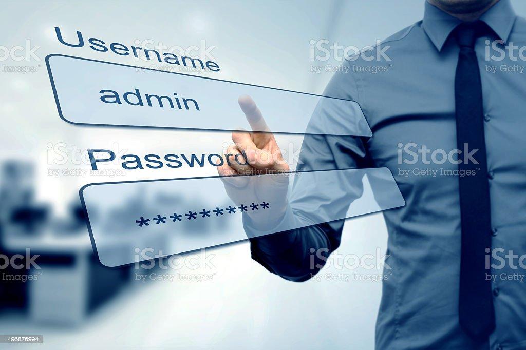 login box - finger pushing username and password fields stock photo