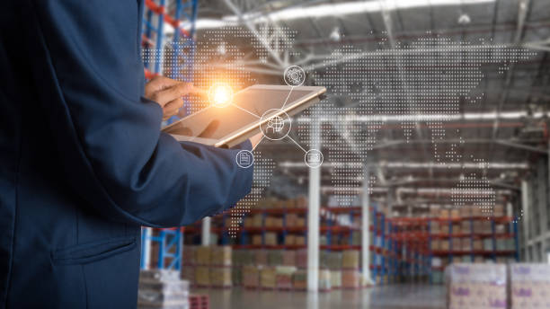logistic and transport concept : businessman manager using tablet check and control and planning for modern trade warehouse logistics. - logistica foto e immagini stock