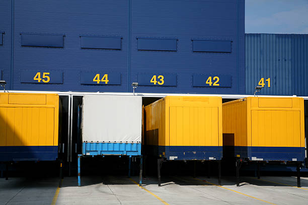 logistic center - lorries unloading stock photos and pictures