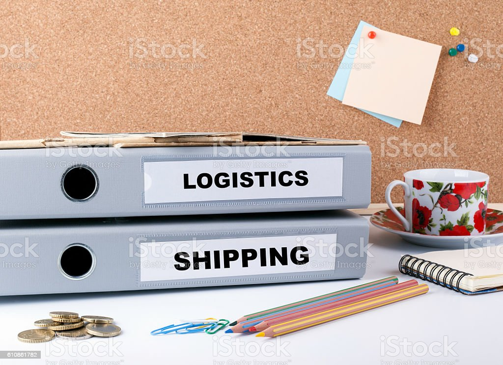 Logistics and Shipping - two folders on white office desk. stock photo