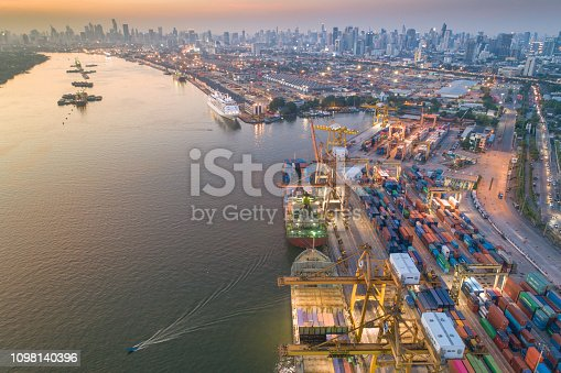 Logistics and transportation of Container Cargo ship and Cargo working crane bridge in shipyard