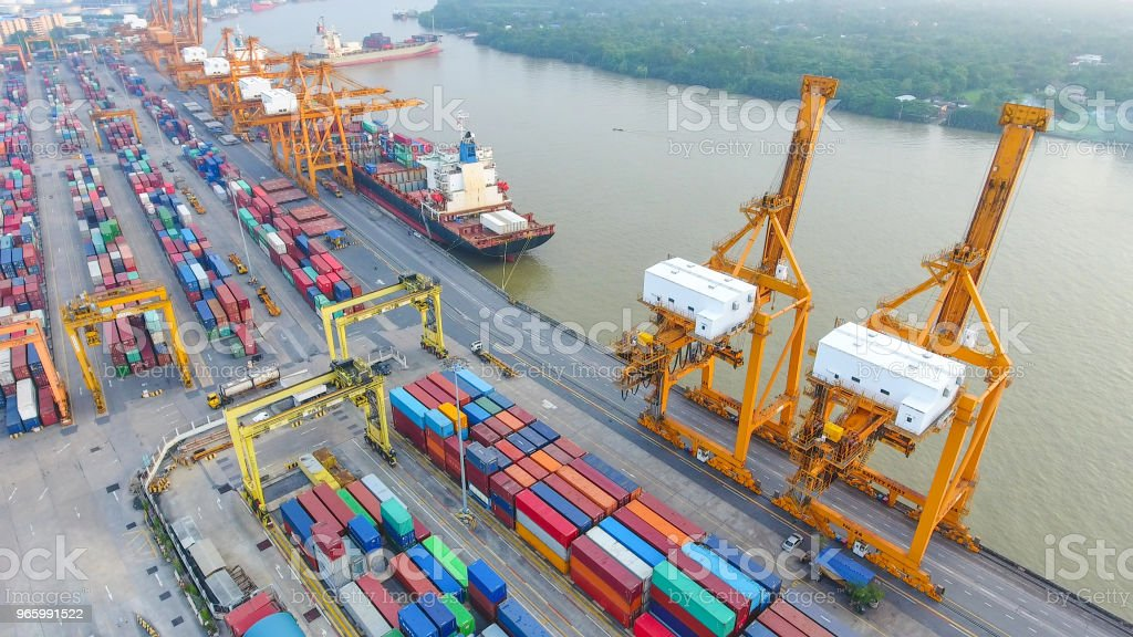 Logistics and transportation of Container Cargo ship and Cargo working crane bridge in shipyard - Royalty-free Above Stock Photo