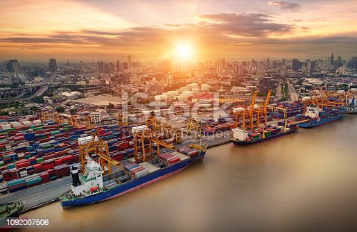 istock Logistics and transportation of Container Cargo ship and Cargo plane with working crane bridge in shipyard, logistic import export and transport industry background 1092007506
