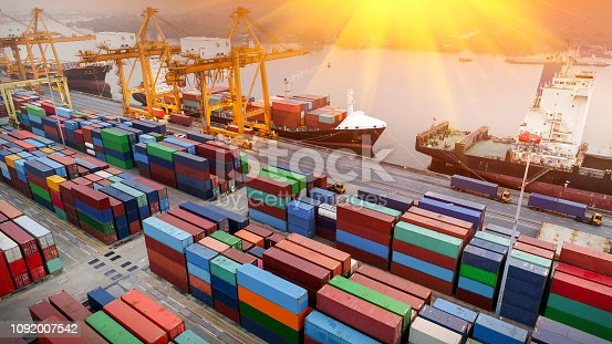 istock Logistics and transportation of Container Cargo ship and Cargo plane with working crane bridge in shipyard at sunrise, logistic import export and transport industry background 1092007542
