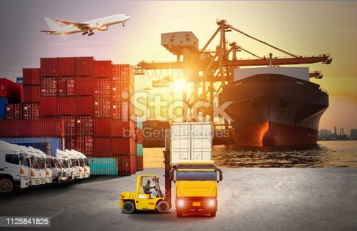 istock Logistics and transportation of Container Cargo ship and Cargo plane with working crane bridge in shipyard at sunrise, logistic import export and transport industry background 1125841825