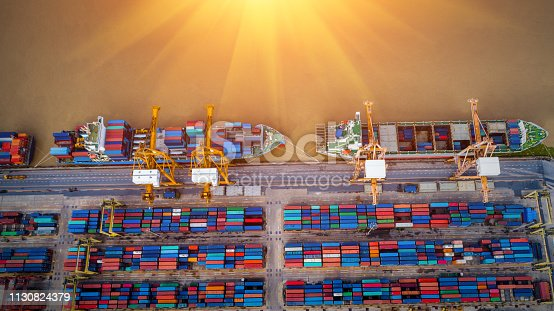istock Logistics and transportation of Container Cargo ship and Cargo plane with working crane bridge in shipyard, logistic import export and transport industry background 1130824379