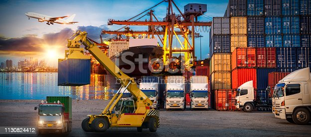 istock Logistics and transportation of Container Cargo ship and Cargo plane with working crane bridge in shipyard at sunrise, logistic import export and transport industry background 1130824412