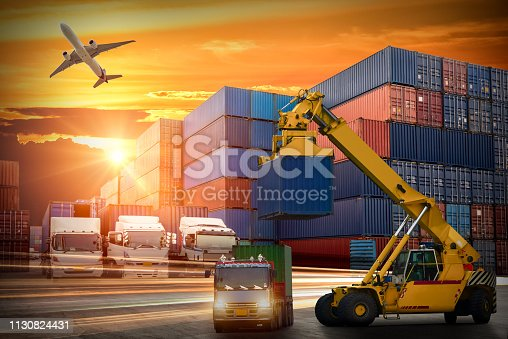 istock Logistics and transportation of Container Cargo ship and Cargo plane with working crane bridge in shipyard at sunset, logistic import export and transport industry background 1130824431