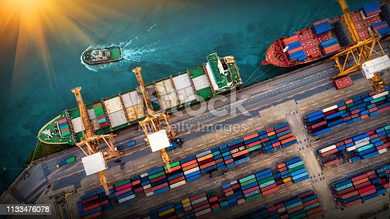 istock Logistics and transportation of Container Cargo ship and Cargo plane with working crane bridge in shipyard at sunrise, logistic import export and transport industry background 1133476078