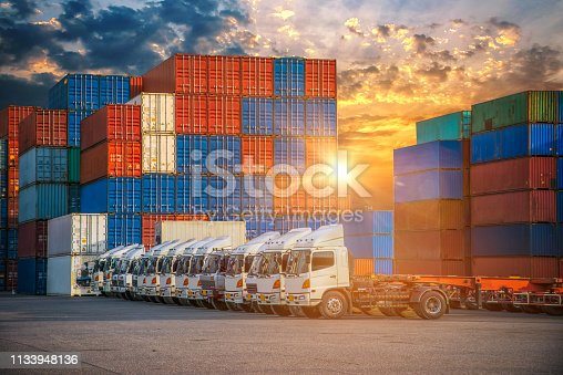 istock Logistics and transportation of Container Cargo ship and Cargo plane with working crane bridge in shipyard, logistic import export and transport industry background 1133948136