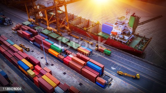 istock Logistics and transportation of Container Cargo ship and Cargo plane with working crane bridge in shipyard, logistic import export and transport industry background 1135428004