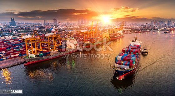 istock Logistics and transportation of Container Cargo ship and Cargo plane with working crane bridge in shipyard at sunset, logistic import export and transport industry background 1144933955