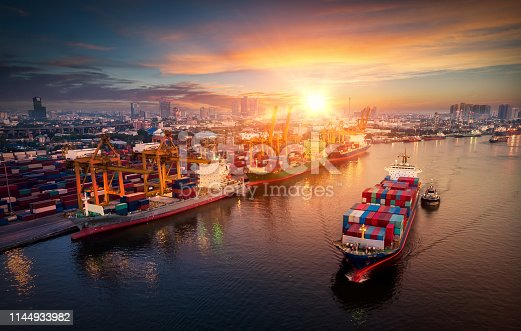istock Logistics and transportation of Container Cargo ship and Cargo plane with working crane bridge in shipyard at sunset, logistic import export and transport industry background 1144933982